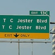 T.C. Jester Boulevard sign over highway SMALL