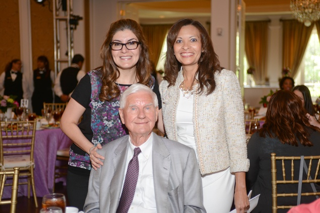 Corina Dominguez, from left, Doug Pitcock and Vivian C. Winslow at the Star of Hope Celebrity Fashion Show May 2014