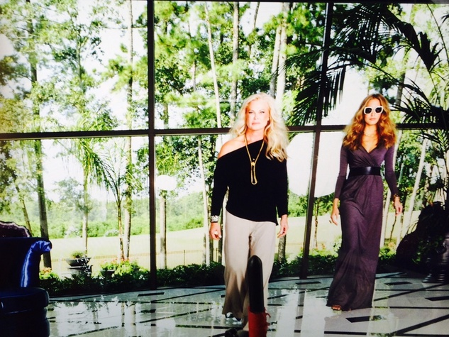 Theresa Roemer and Nicole Kaspar model Roemer's new clothing line as seen on computer monitor