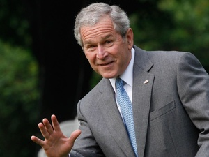 George W. Bush, waving, smiling