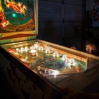 Humans of San Antonio Michael Cirlos photography project kid pinball machine