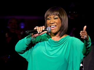 Patti LaBelle singing into mic