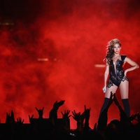 Beyonce, Super Bowl, on stage, red background, February 2013