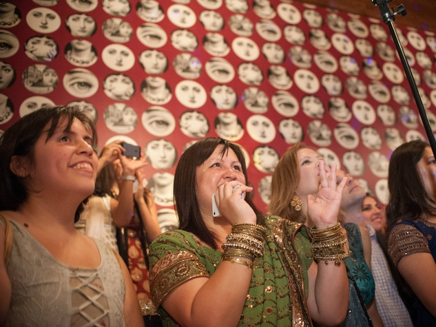 Partygoers enjoy dance performance at Bollywood Ball
