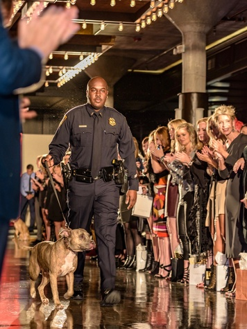 First responder and pet at Salute Houston fashion show