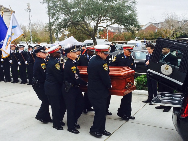 Bob Lanier casket is moved to hearse at his funeral