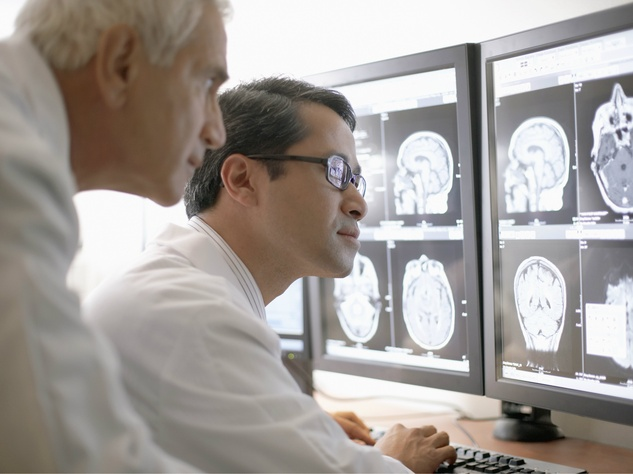 Radiologists looking at scans