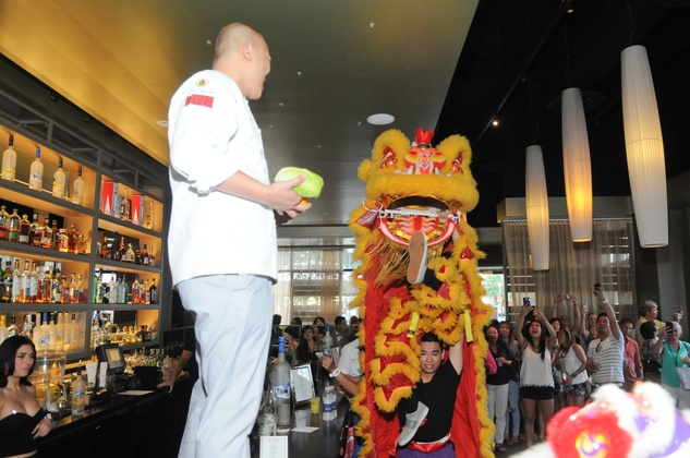 Lion Dancer performers with chef at the Curry Crawl May 2014