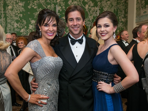 20 Kathy and Stuart Dupuy, from left, with Grace Dupuy at the Trees of Hope Gala November 2014