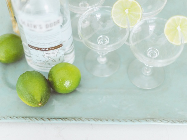 Bar stocked with gin and limes