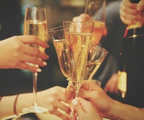Stock photo of friends toasting champagne