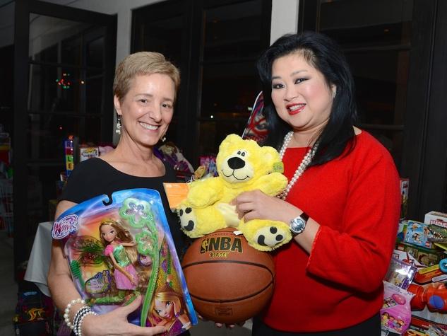 19 Brenda Koch, left, and Gigi Huang at Joyful Toyful December 2014