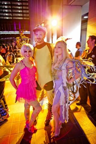 221 Brandi Bowers, from left, Joel Moms and Kiersten Clingman at the Art Car Ball April 2015