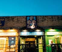 exterior of Fado Irish Pub at night