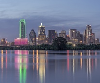 Downtown Dallas behind flooded Trinity River