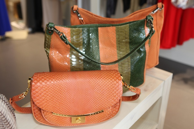 Shiny python Hayward clutches at Atrium trunk show