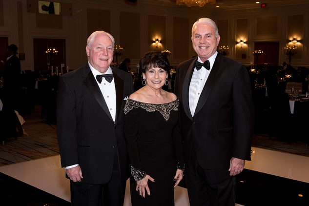 15 Barry and Rosalyn Margolis, left, with Mark A. Wallace at the Jewish Community Center Children's Scholarship Ball March 2015