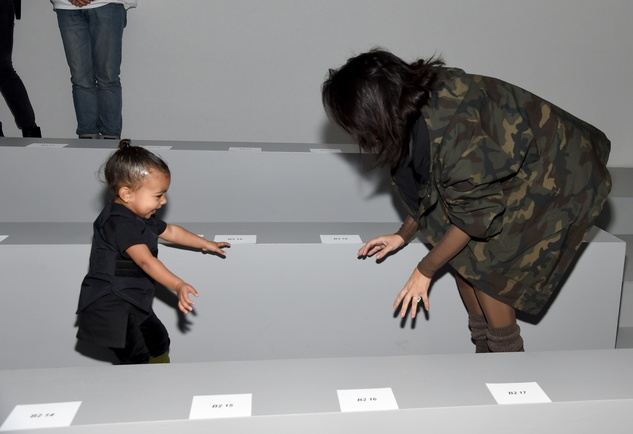 Kim Kardashian and North West at the adidas Originals x Kanye West YEEZY SEASON 1 fashion show