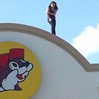 woman on Buc-ee's roof 2 June 2013