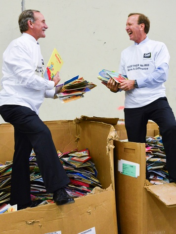 Marty Goossen, left, and Neil Bush at the Books Between Kids project November 2013