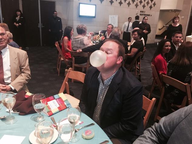 News, Shelby, Casa de Esperanza dinner, April 2015, blowing bubbles