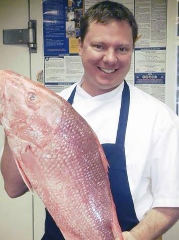 chef Ben McPherson of Batanga holding fish