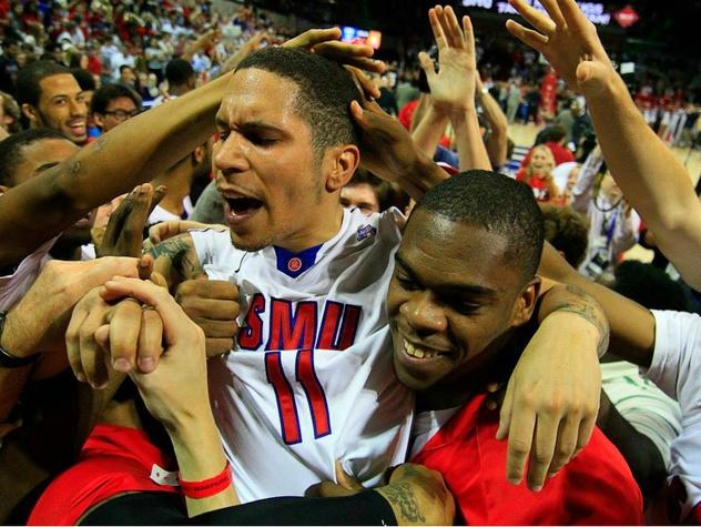 SMU basketball players celebrating big win