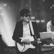Phoenix guitarist in glasses