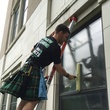 Houston, Men In Kilts, May 2015, employee cleaning window