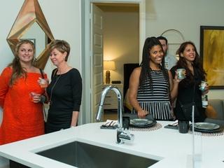 Guests tour Marq 31 apartment at CultureMap Summer Social