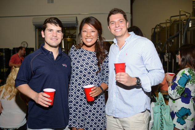 30. Thompson Barro, from left, Mi-Sun Bae and Chandler Broz at the Bayou Preservation Association Herons party June 2014