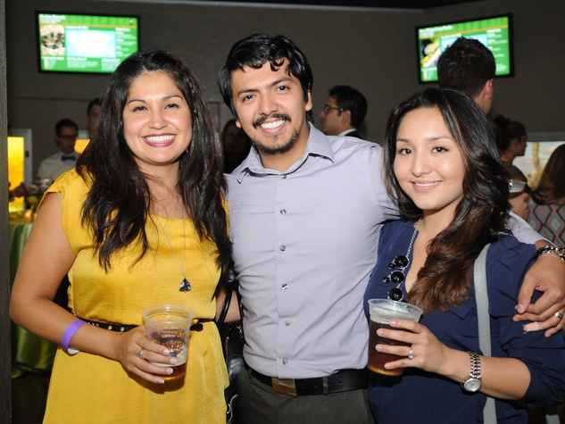 9836 Jessica Rodriguez, from left, Alberto Garcia and Jessica Valdez at the Scales and Cocktails Houston Zoo Flock event