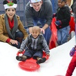 11 Michelle Detts, left and Matt Hibbetts with a young resident at Mission of Yahweh's gift-giving celebration December 2013