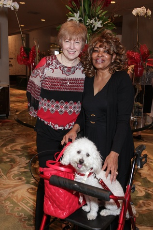 1 Kay Tegeler, left, and Lucille Bogany with Prince at the Best Friends Brunch benefiting aniMeals on Wheels February 2015