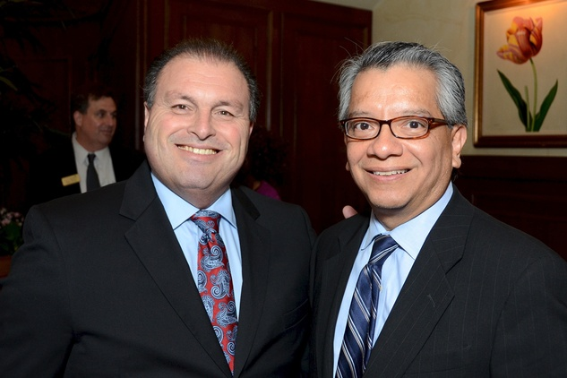 42 Larry Elizondo, left,  and David Ruiz at the Houston Food Bank dinner April 2014
