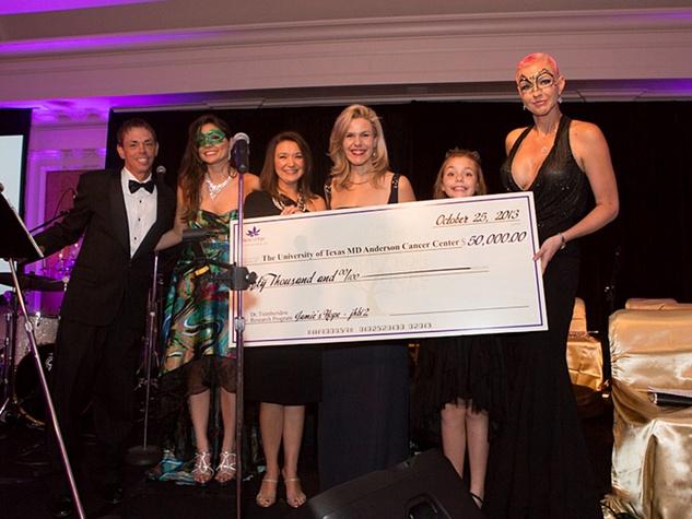 5 check at Hope Masquerade for a Cure Gala November 2013