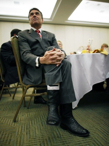 Rick Perry wearing come and take it cowboy boots