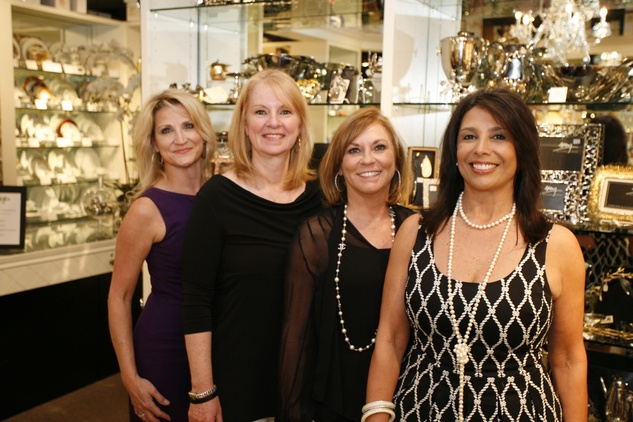 9 Lisa Garcia, from left, Susan Wagner, Belinda Phelps and Regina Garcia at Events' Shop With Heart Card launch party April 2014
