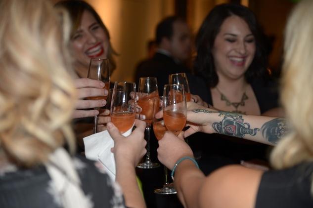 girls toasting at the David Peck runway show September 2014