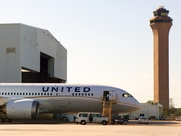United Dreamliner airplane at IAH with control tower