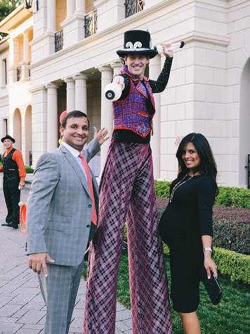 Cody and Kusum Patel with Stilt Walker at The Memorial Hermann at the Under the Boardwalk kickoff party