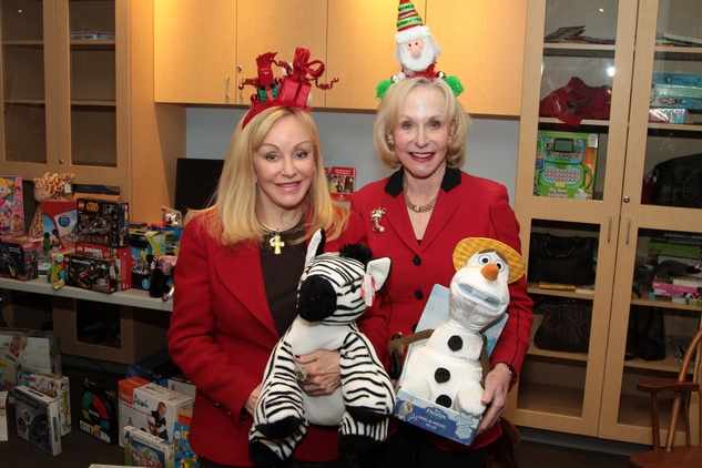 75 Judi McGee, left, and Carolyn Mann at Santa visits Texas Children's Cancer Center December 2014