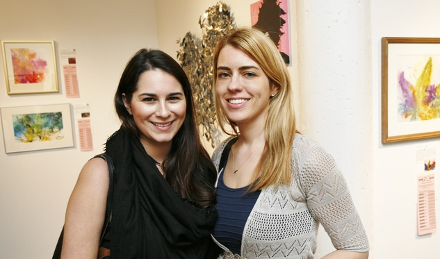 Hayley Perez and Tara Quell enjoy the diverse collection of artwork at the 19th annual Art on the Avenue Preview Party