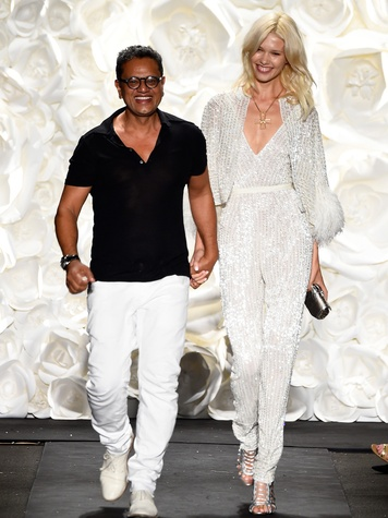 Fashion Week spring 2015 Designer Naeem Khan and a model