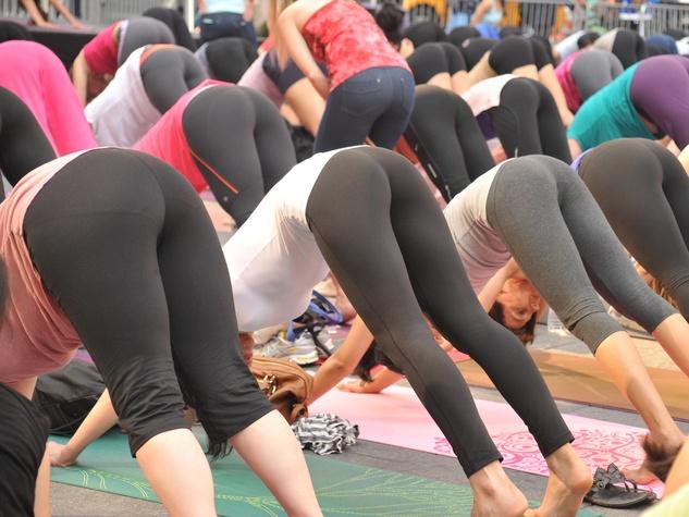 Lulumon women wearing tights workout pants bottoms up yoga position