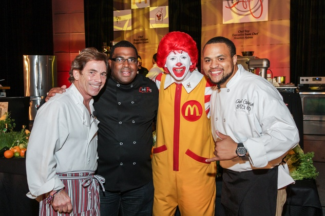 7308 Bruce Molzan, from left, Rey Darthard, Ronald and Michael Gabriel at the Ronald McDonald House Charities first fundraiser October 2014