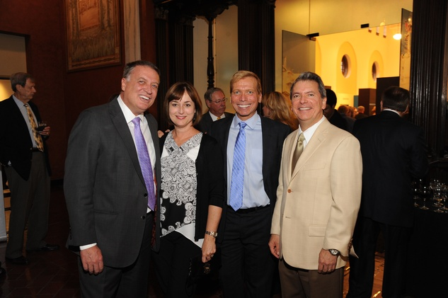 8 5681 Marc Melcher, from left, Leigh Smith, Jonathon Glus and Roland Garcia Jr. at the Port of Houston library exhibition celebration September 2014
