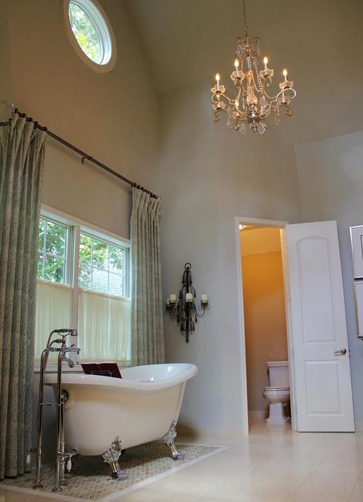 Porch.com By Design Interiors bathroom claw foot