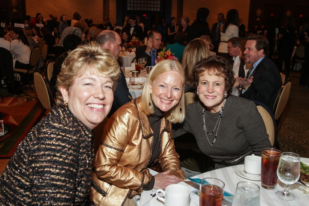 Kelly Zuniga, from left, Trish Morille and Regina Rogers at the National Philanthropy Day Awards November 2014