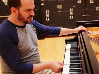 1 Kirill Gerstein prepares piano for Houston Symphony performance September 2013